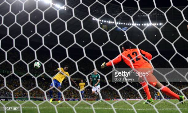 Jo of Brazil scores his team's second goal past Jose de Jesus Corona of Mexico during the FIFA Confederations Cup Brazil 2013 Group A match between...