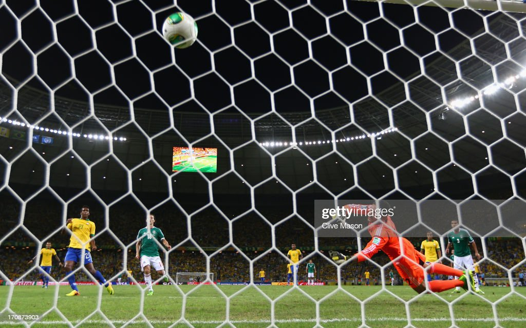 Jo of Brazil scores his team's second goal past Jose de Jesus Corona of Mexico during the FIFA Confederations Cup Brazil 2013 Group A match between Brazil and Mexico at Castelao on June 19, 2013 in Fortaleza, Brazil.