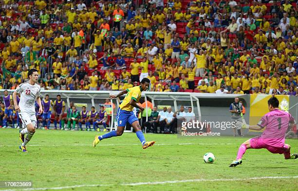 Jo of Brazil scores his team's third goal during the FIFA Confederations Cup Brazil 2013 Group A match between Brazil and Japan at National Stadium...