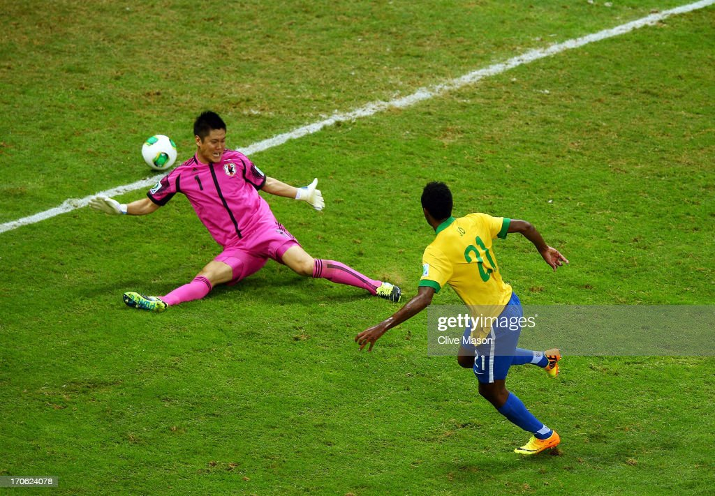 Jo of Brazil scores his team's third goal past <a gi-track='captionPersonalityLinkClicked' href=/galleries/search?phrase=Eiji+Kawashima&family=editorial&specificpeople=3117136 ng-click='$event.stopPropagation()'>Eiji Kawashima</a> of Japan during the FIFA Confederations Cup Brazil 2013 Group A match between Brazil and Japan at National Stadium on June 15, 2013 in Brasilia, Brazil.
