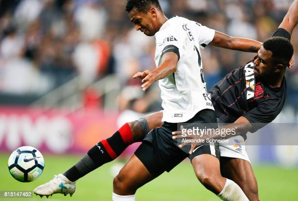 Jo of Corinthians and Douglas Coutinho of Atletico PR in action during the match between Corinthians and Atletico PR for the Brasileirao Series A...