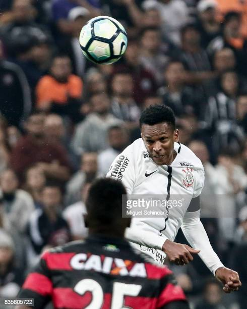Jo of Corinthians vies for the ball with Kanu of Vitoria during the match between Corinthians and Vitoria for the Brasileirao Series A 2017 at Arena...