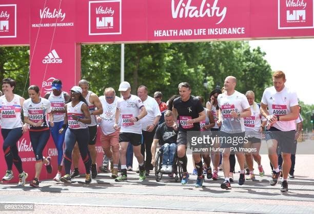 Jo Pavey David Weir and Lord Sebastian Coe on the start line of the 'Olympians Mile' part of the Vitality Westminster Mile on The Mall in central...
