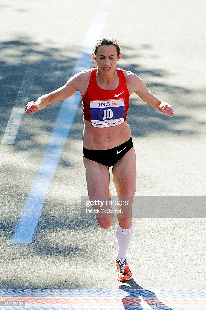<a gi-track='captionPersonalityLinkClicked' href=/galleries/search?phrase=Jo+Pavey&family=editorial&specificpeople=2299606 ng-click='$event.stopPropagation()'>Jo Pavey</a> of Great Britain celebrates as she finishes in ninth place in the Women's Division of the 42nd ING New York City Marathon on November 6, 2011 in New York City