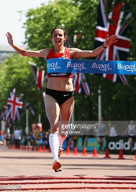 Jo Pavey of Great Britain crosses the line to win the Women's Bupa London 10000 Run on May 30 2011 in London England