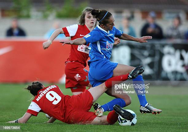 Jo Potter of Birmingham City tackled by AnnMarie Heatherson of Bristol Acadamy during The FA Women's Super League match between Birmingham City...