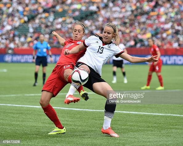 Jo Potter of England and Lena Petermann of Germany battle for the ball during the FIFA Women's World Cup Canada 2015 Third Place Playoff match...