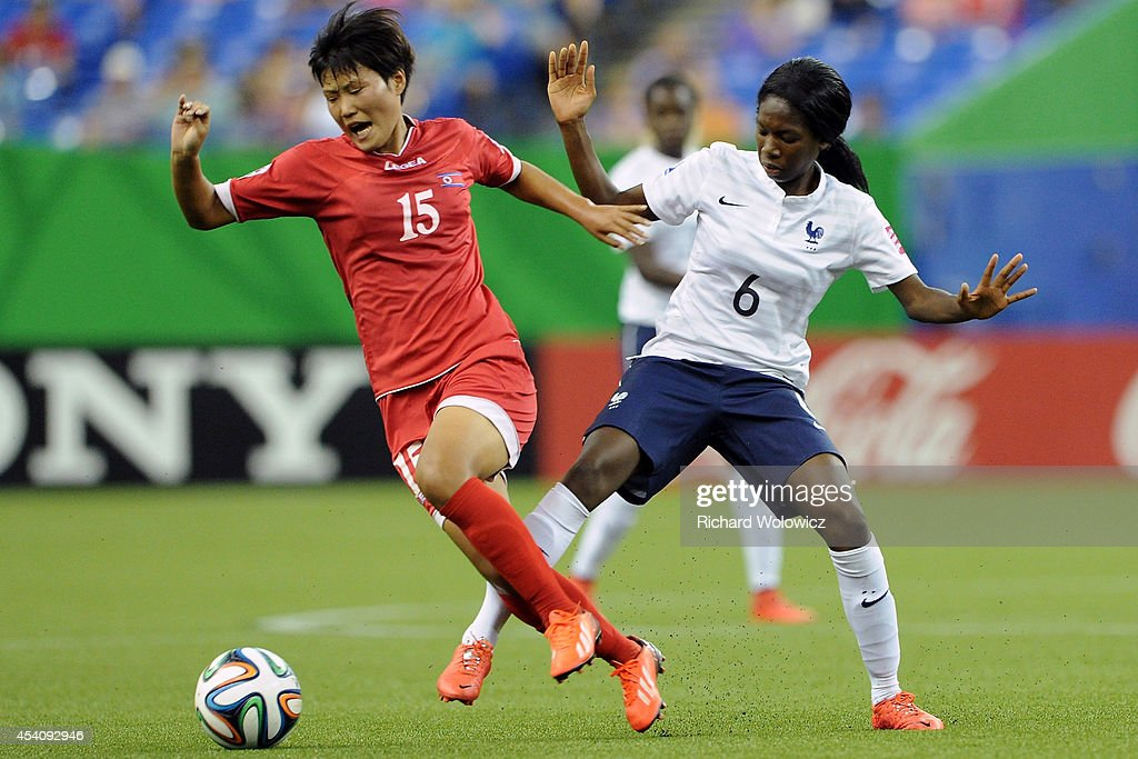 Jo Ryon Hwa of Korea DPR strips the ball from Aminata Diallo of France during the FIFA Women's U-20 3rd place game at Olympic Stadium on August 24, 2014 in Montreal, Quebec, Canada. France defeated Korea DPR 3-2.