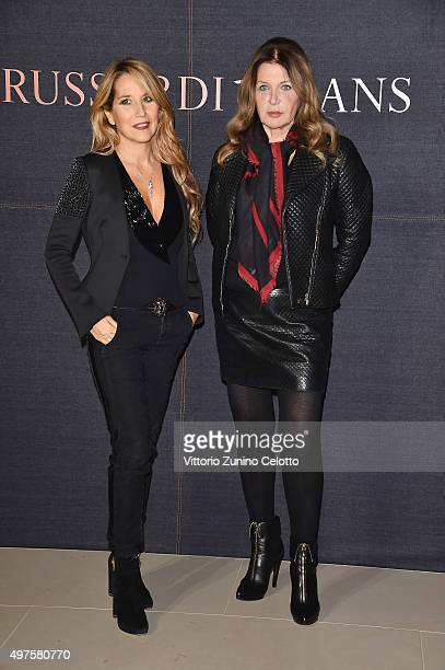 Jo Squillo and Maria Luisa Trussardi attend a photocall for 'Trussardi Jeans Celebrates The New IT Bag' party on November 17 2015 in Milan Italy