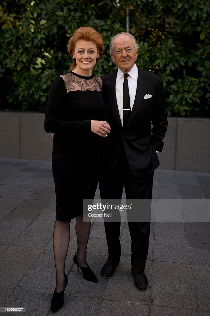 Jo Staffelbach and Andre Staffelbach arrive for the 2013 TWO x TWO for AIDS and Art Gala at the Rachofsky House on October 26, 2013 in Dallas, Texas.