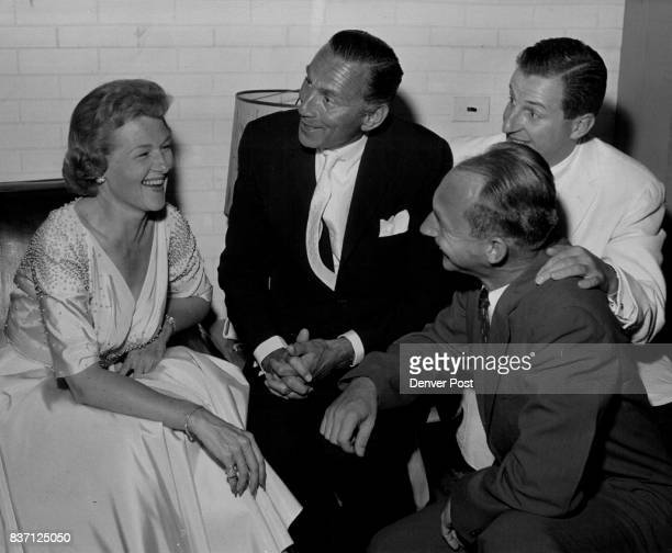 Jo Stafford popular recording star attracts the interest of three Columbia Records officials during a show for dealers at the Stanley hotel in Estes...