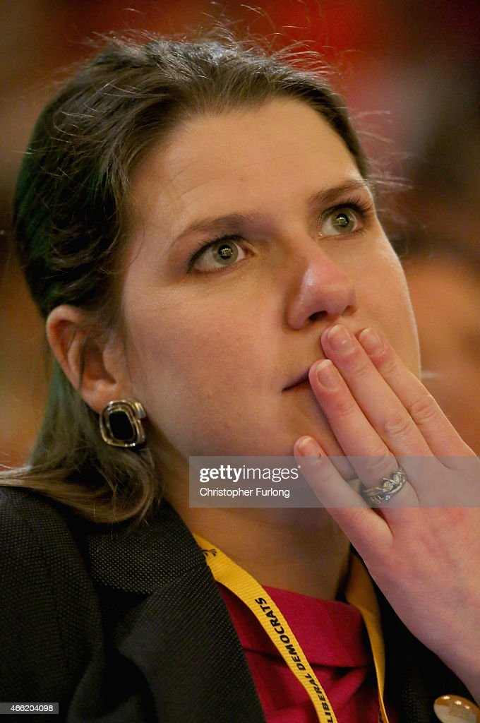 Jo Swinson MP, Under Secretary of State for Women and Equalities listens to business secretary Vince Cable delivering his keynote speech during the party's spring conference at the ACC on March 14, 2015 in Liverpool, England. Deputy Prime Minister Nick Clegg confirmed today that Mental health services in England will receive £1.25bn in next week's Budget.