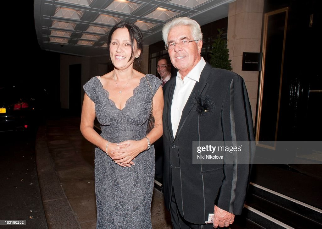 Jo Westwoo and <a gi-track='captionPersonalityLinkClicked' href=/galleries/search?phrase=Max+Clifford&family=editorial&specificpeople=753579 ng-click='$event.stopPropagation()'>Max Clifford</a> sighted leaving the Dorchester Hotel, Park Lane on October 5, 2013 in London, England.