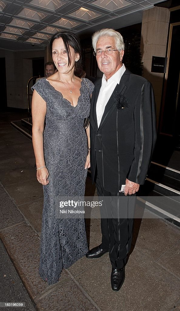 Jo Westwood and <a gi-track='captionPersonalityLinkClicked' href=/galleries/search?phrase=Max+Clifford&family=editorial&specificpeople=753579 ng-click='$event.stopPropagation()'>Max Clifford</a> are sighted leaving the Dorchester Hotel, Park Lane on October 5, 2013 in London, England.