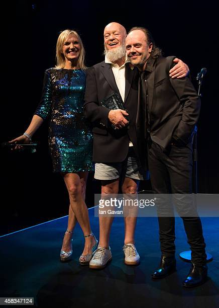 Jo Whiley Michael Eavis and Lars Ulrich on stage during the Music Industry Trust Awards at Grosvenor House Hotel on November 3 2014 in London England...