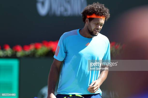 Jo Wilfred Tsonga reacts after losing a game during the second round of the BNP Paribas Open on March 11 at the Indian Wells Tennis Gardens in Indian...