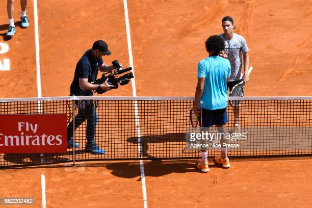 Jo Wilfried Tsonga an Adrian Mannarino of France handshakes during the Monte Carlo Rolex Masters 2017 on April 18 2017 in Monaco Monaco