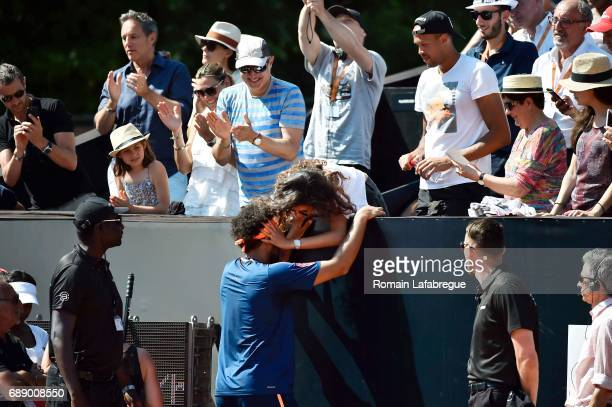 Jo Wilfried Tsonga of France celebrates winning with his wife Noura El Swikh the Final of Open Parc of Lyon 2017 on May 27 2017 in Lyon France
