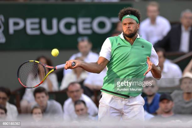 Jo Wilfried Tsonga of France plays a forehand during his men's single match against Renzo Olivo of Argentina on day three of the 2017 French Open at...
