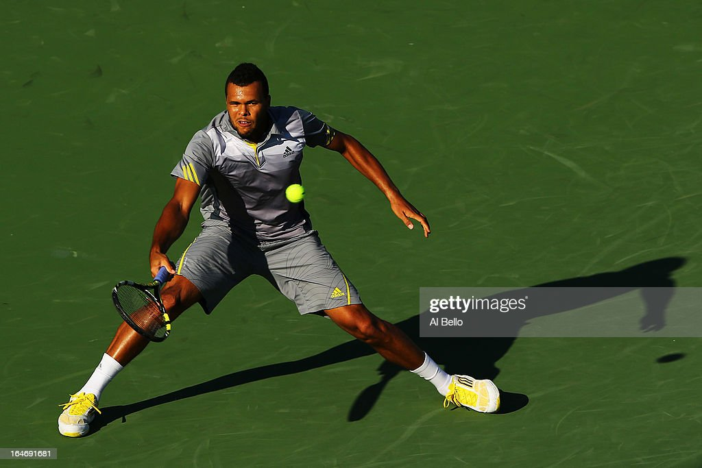 Jo Wilfried Tsonga of France returns a shot to Marin Cilic of Croatia during Day 9 of the Sony Open at the Crandon Park Tennis Center on March 26, 2013 in Key Biscayne, Florida.