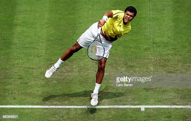 Jo Wilfried Tsonga of France serves during his first round match against Fabrice Santoro of France on day 2 of the Gerry Weber Open at the Gerry...