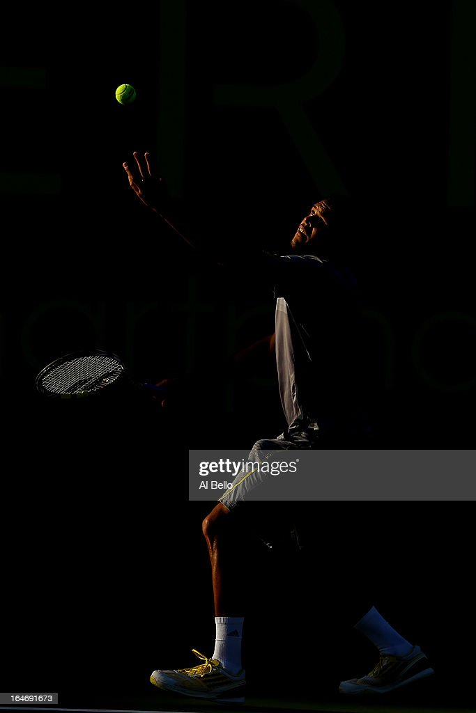 Jo Wilfried Tsonga of France serves to Marin Cilic of Croatia during Day 9 of the Sony Open at the Crandon Park Tennis Center on March 26, 2013 in Key Biscayne, Florida.