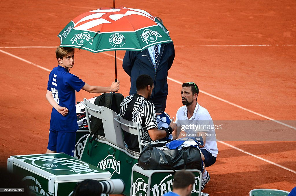 Jo Wilfried Tsonga retires from the match due to injury during the Men's Singles third round on day seven of the French Open 2016 on May 28, 2016 in Paris, France.