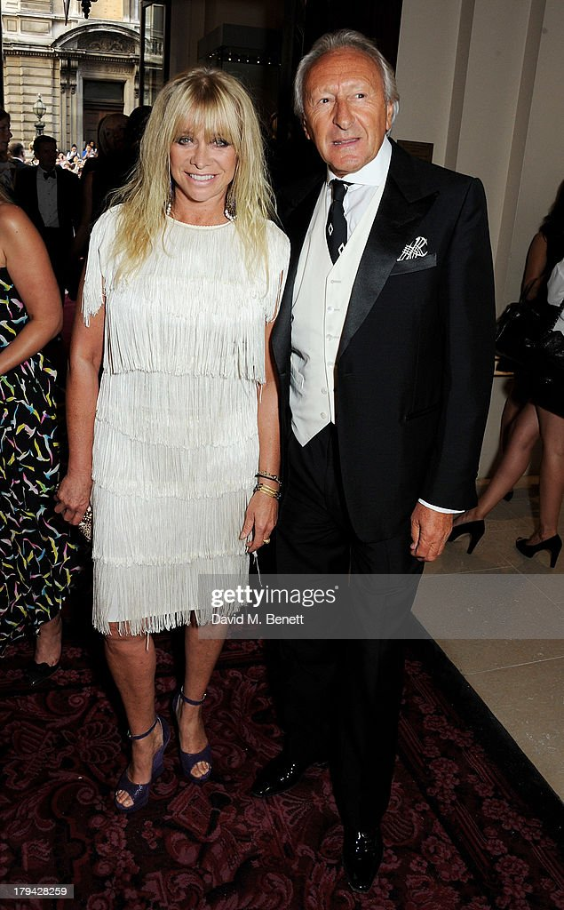 Jo Wood (L) and Harold Tillman arrive at the GQ Men of the Year awards at The Royal Opera House on September 3, 2013 in London, England.