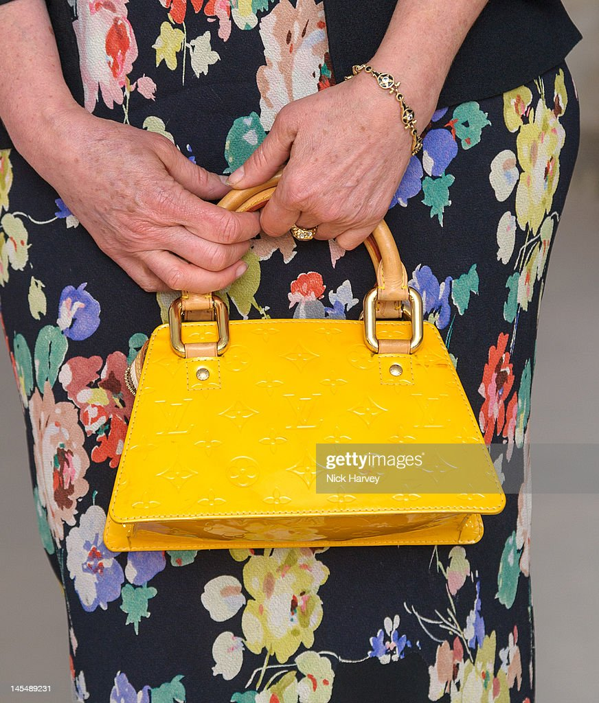 <a gi-track='captionPersonalityLinkClicked' href=/galleries/search?phrase=Jo+Wood&family=editorial&specificpeople=241556 ng-click='$event.stopPropagation()'>Jo Wood</a> handbag detail attends the private VIP view of Royal Academy Summer Exhibition 2012 at Royal Academy of Arts on May 30, 2012 in London, England.