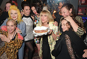 Jo Wood poses with guests including Brix SmithStart Pam Hogg Gizzi Erskine Amy Molyneaux and Leah Wood at her surprise birthday party at L'Escargot...