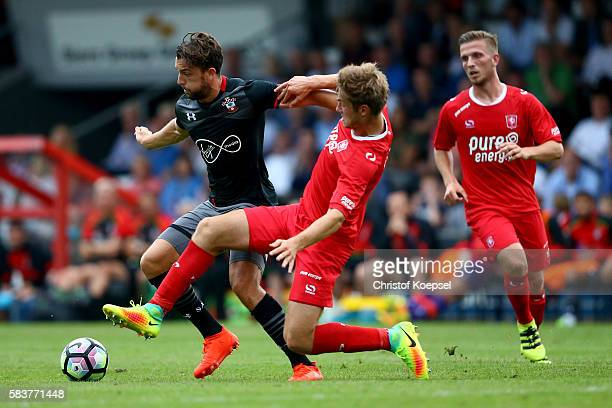 Joachim Andersen of Enschede challenges Jay Rodriguez of Southampton during the friendly match between Twente Enschede and FC Southampton at Q20...