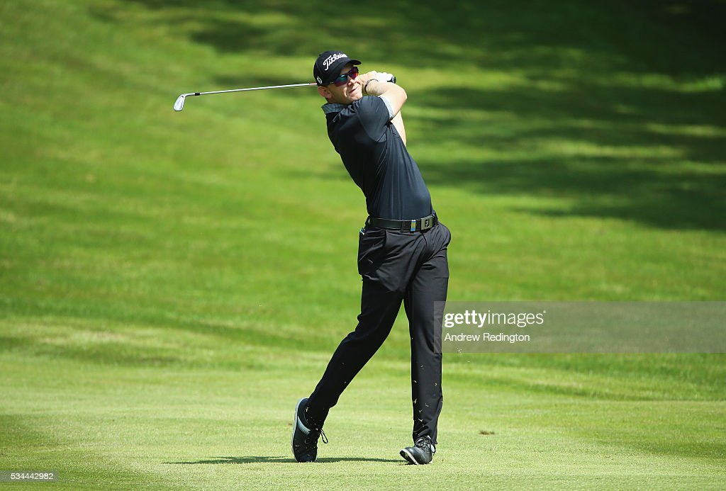 Joachim B. Hansen of Denmark hits his 2nd shot on the 4th hole during day one of the BMW PGA Championship at Wentworth on May 26, 2016 in Virginia Water, England.