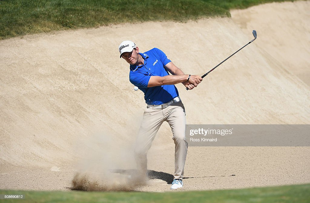 Joachim B. Hansen of Denmark plays from a bunker on the 18th hole during the third round of the Omega Dubai Desert Classic at the Emirates Golf Club on February 6, 2016 in Dubai, United Arab Emirates.