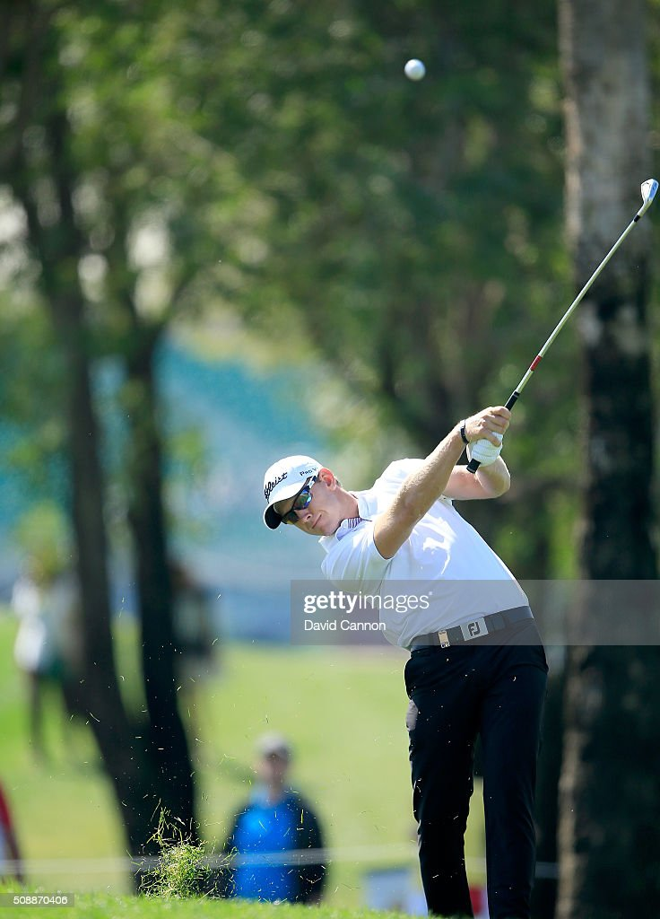 Joachim B. Hansen of Denmark plays his second shot at the par 4, first hole during the final round of the 2016 Omega Dubai Desert Classic on the Majlis Course at the Emirates Golf Club on February 7, 2016 in Dubai, United Arab Emirates.