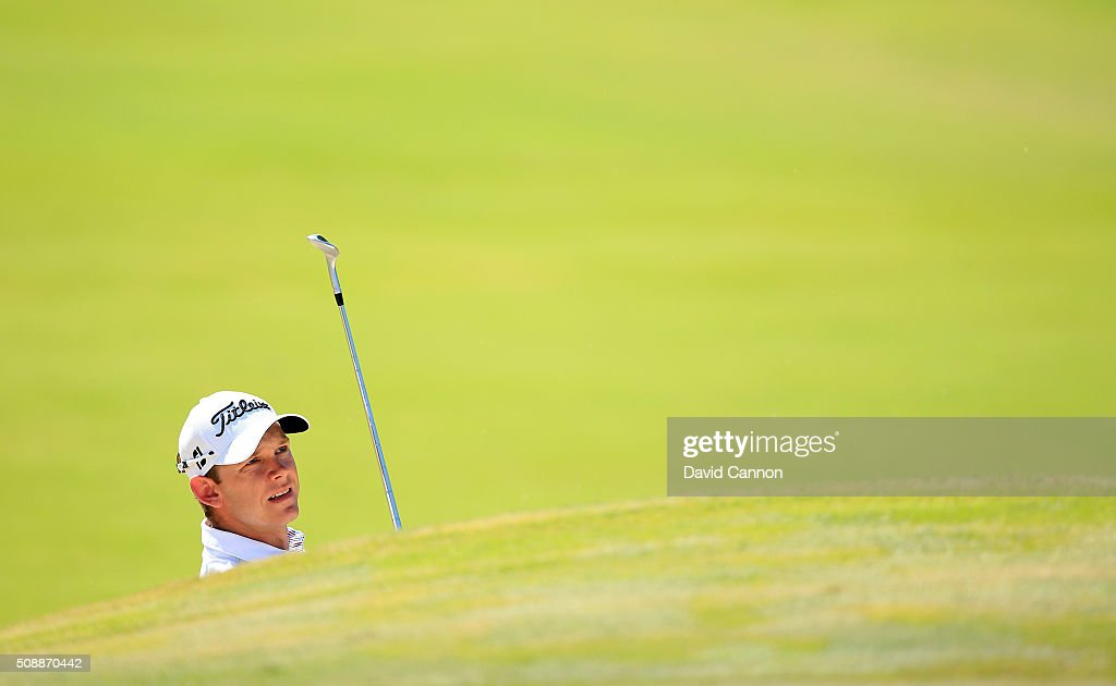 Joachim B. Hansen of Denmark plays his third shot at the par 4, first hole during the final round of the 2016 Omega Dubai Desert Classic on the Majlis Course at the Emirates Golf Club on February 7, 2016 in Dubai, United Arab Emirates.