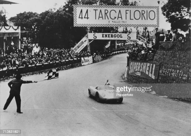 Joachim Bonnier of Sweden driving the Porsche KG Porsche 718 RS60 Spyder takes the chequered flag to win the 44th Targa Florio on 8 May 1960 at the...