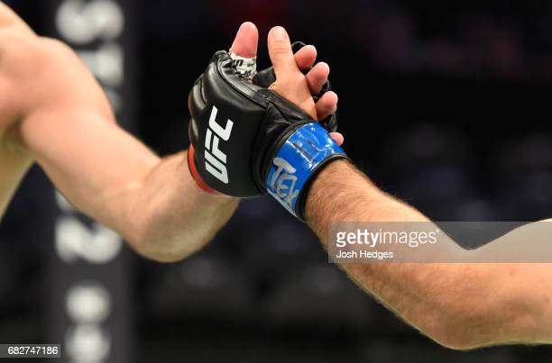 Joachim Christensen touches gloves with Gadzhimurad Antigulov in their light heavyweight fight during the UFC 211 event at the American Airlines...