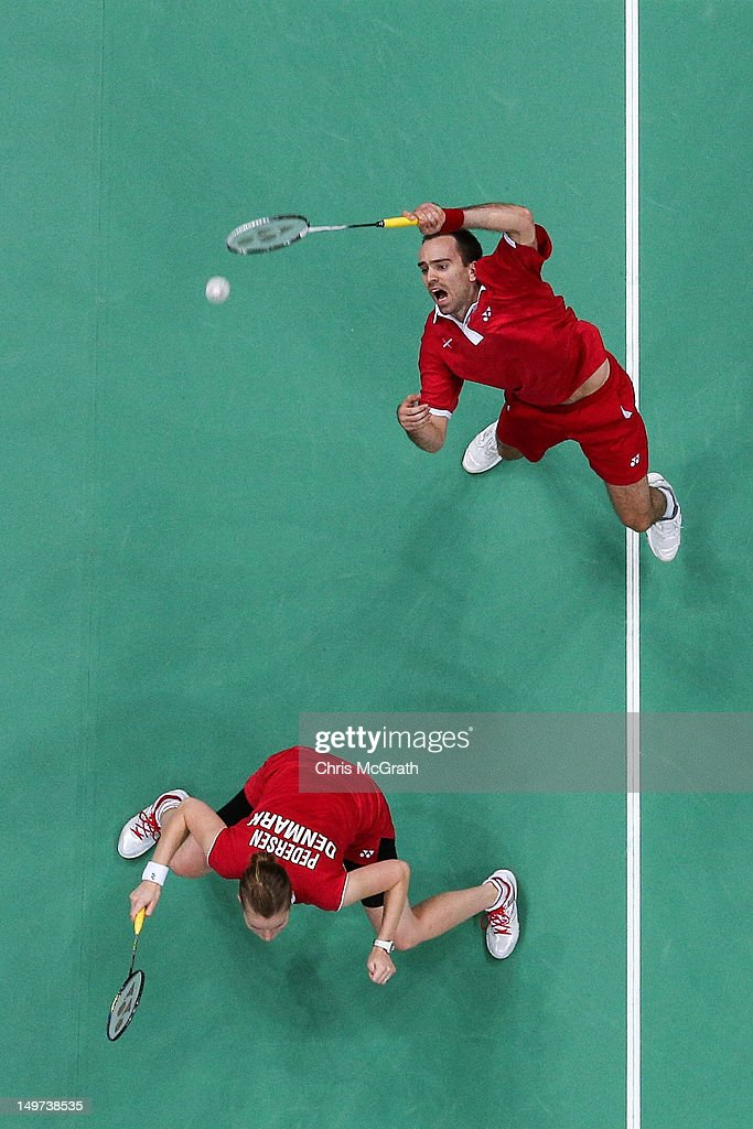 Joachim Fischer (L) and <a gi-track='captionPersonalityLinkClicked' href=/galleries/search?phrase=Christinna+Pedersen&family=editorial&specificpeople=5933396 ng-click='$event.stopPropagation()'>Christinna Pedersen</a> of Denmark compete in the Mixed Doubles Badminton Bronze Medal match against Tontowi Ahmad and Liliyana Natsir of Indonesia on Day 7 of the London 2012 Olympic Games at Wembley Arena on August 3, 2012 in London, England.