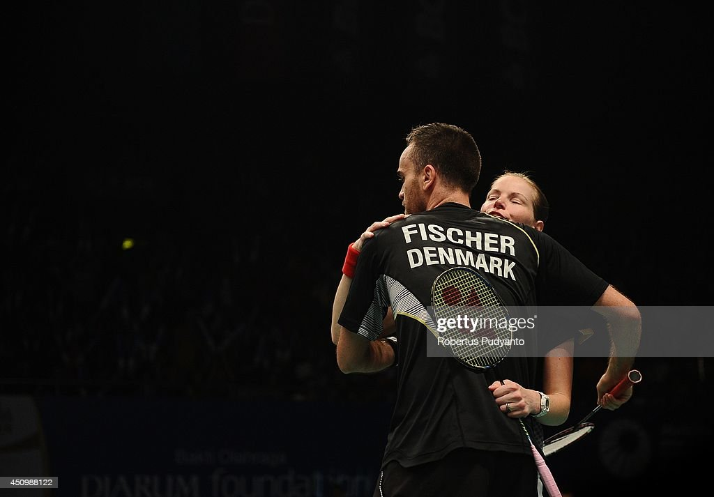 <a gi-track='captionPersonalityLinkClicked' href=/galleries/search?phrase=Joachim+Fischer+Nielsen&family=editorial&specificpeople=5851511 ng-click='$event.stopPropagation()'>Joachim Fischer Nielsen</a> and <a gi-track='captionPersonalityLinkClicked' href=/galleries/search?phrase=Christinna+Pedersen&family=editorial&specificpeople=5933396 ng-click='$event.stopPropagation()'>Christinna Pedersen</a> of Denmark react as they win the game against Lee Yong Dae and Shin Seung Chan of Korea during the semifinal BCA Indonesia Open 2014 MetLife BWF World Super Series Premier at Istora Gelora Bung Karno Stadium on June 21, 2014 in Jakarta, Indonesia.