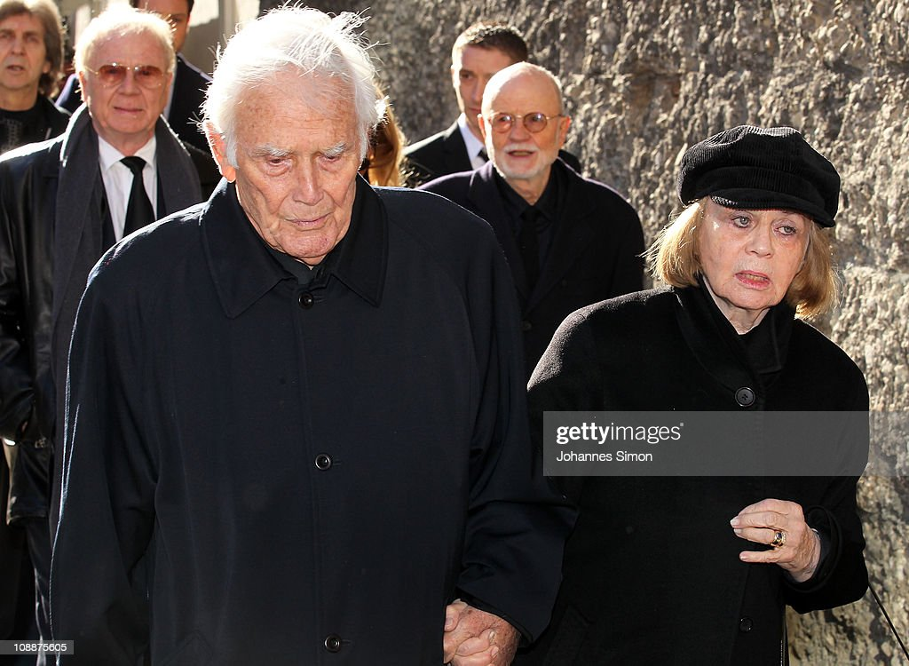 Joachim Fuchsberger (L) and his wife Gundel Fuchsberger attend the memorial service for Bernd Eichinger at the St. Michael Kirche on February 07, 2011 in Munich, Germany. Producer Bernd Eichinger died of a heart attack in Los Angeles on January 24. Leading the Constantin Film he produced films like 'Perfume', 'Christiane F.', 'Smillas Sense of Snow' or 'Der Untergang' receiving multiple awards.