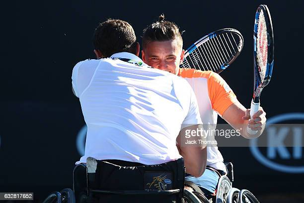 Joachim Gerard of Belgium and Gordon Reid of Great Britain celebrate winning their Men's Wheelchair Doubles Final against Gustavo Fernandez of...