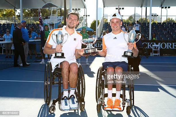Joachim Gerard of Belgium and Gordon Reid of Great Britain pose with their trophies after winning their Men's Wheelchair Doubles Final against...