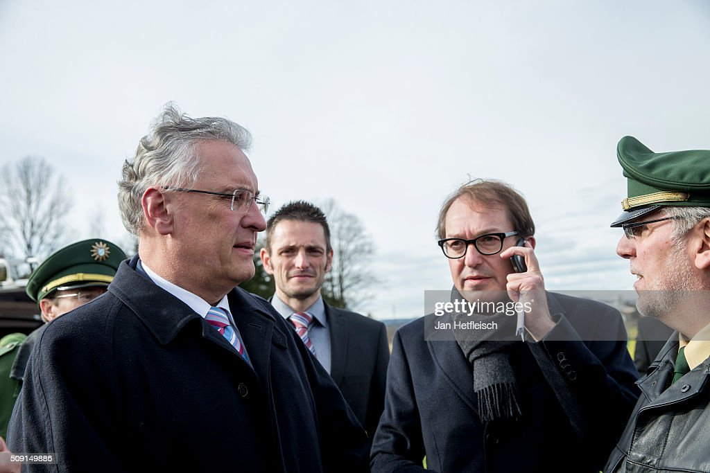 Joachim Herrmann (L), Bavarian Minister of Interior and <a gi-track='captionPersonalityLinkClicked' href=/galleries/search?phrase=Alexander+Dobrindt&family=editorial&specificpeople=5702301 ng-click='$event.stopPropagation()'>Alexander Dobrindt</a> (C), German Minister of Transport, arrive at the site where two trains collided head-on several hours before in Bavaria on February 9, 2016 near Bad Aibling, Germany. Authorities say at least nine people are dead and over 100 injured in the collision between two trains of the Meridian local commuter train service that occurred at approximately 7 am.