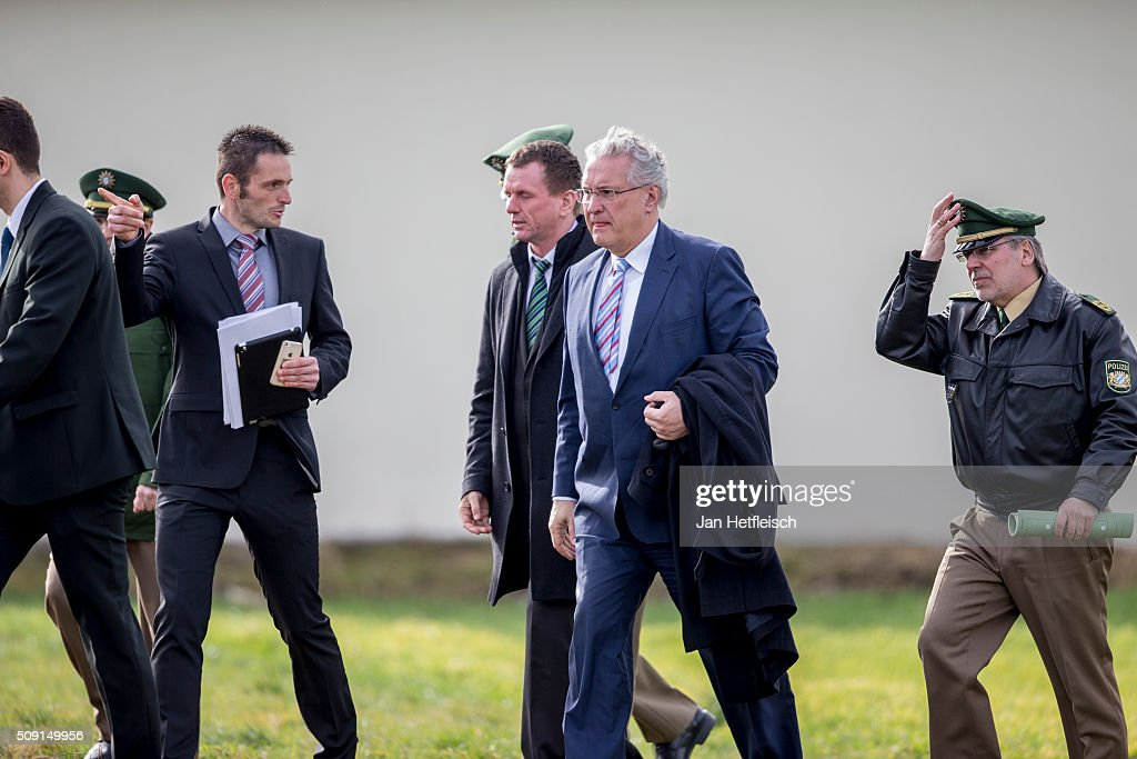 Joachim Herrmann (L), Bavarian Minister of Interior arrives at the site where two trains collided head-on several hours before in Bavaria on February 9, 2016 near Bad Aibling, Germany. Authorities say at least nine people are dead and over 100 injured in the collision between two trains of the Meridian local commuter train service that occurred at approximately 7 am.