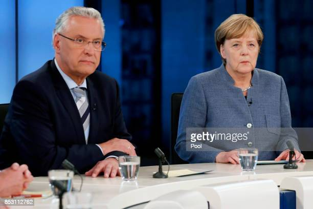 Joachim Herrmann Bavarian Minister of the Interior and German Chancellor Angela Merkel of the Christian Democratic Union attend a TV discussion with...