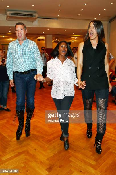 Joachim Llambi and Jorge Gonzalez walk in high heel shoes while Motsi Mabuse smiles during the IN Magazin Dance Club event at dancing school Reichelt...