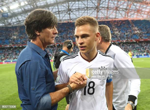Joachim Loew coach of Germany and Joshua Kimmich of Germany celebrate after the FIFA Confederations Cup Russia 2017 Group B match between Germany and...