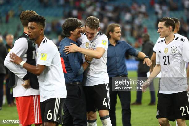 Joachim Loew coach of Germany and Matthias Ginter of Germany celebrate after the FIFA Confederations Cup Russia 2017 Group B match between Germany...
