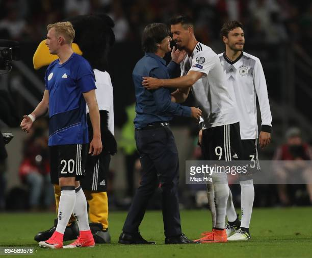 Joachim Loew coach of Germany and Sandro Wagner of Germany embrace after the FIFA 2018 World Cup Qualifier between Germany and San Marino at Stadion...