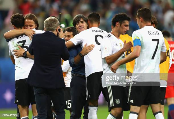 Joachim Loew coach of Germany and Sandro Wagner of Germany embrace after the FIFA Confederations Cup Russia 2017 Final between Chile and Germany at...